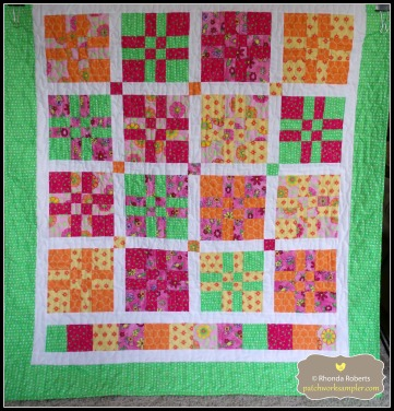 Another donation quilt made out of scraps from a shop sample I made awhile ago.  The pattern is a Disappearing Four Patch (or 4 into 9 Patch).  You can find several tutorials online--just search one of the titles!