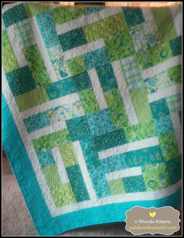 Another quilt from Amelie Scott called Bundle of 12.  It uses 12 fat quarters and a background.  The pattern is for sale at Craftsy.com.  This quilt is also for donation.