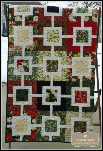 This quilt is called Courtyard Maze and is from a pattern by OliveTree Patterns.  It is made from a Christmas jelly roll.