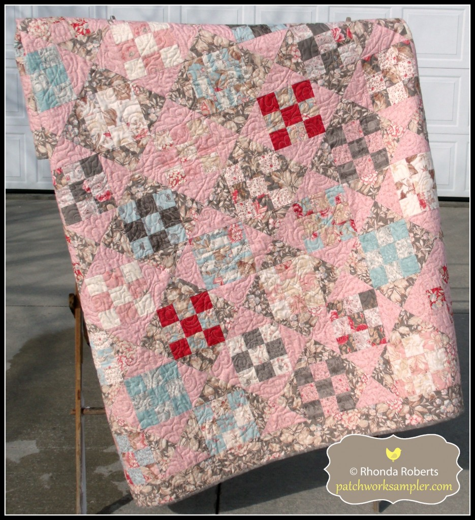 Nine Patch and Hourglass made from a jelly roll of Papillon fabric.  It looks really pink in the photo but it's much softer in person.