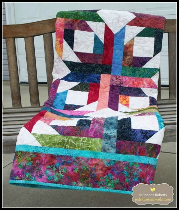 This is Pineapple Blossom, a free pattern from Bonnie K. Hunter at Quiltville.com.  It is made from batik scraps.