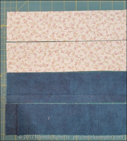 two strips each background and contrast fabrics