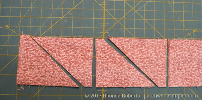 four sets of half square triangles for carpenter's star block