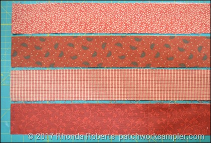 four strips of print fabric