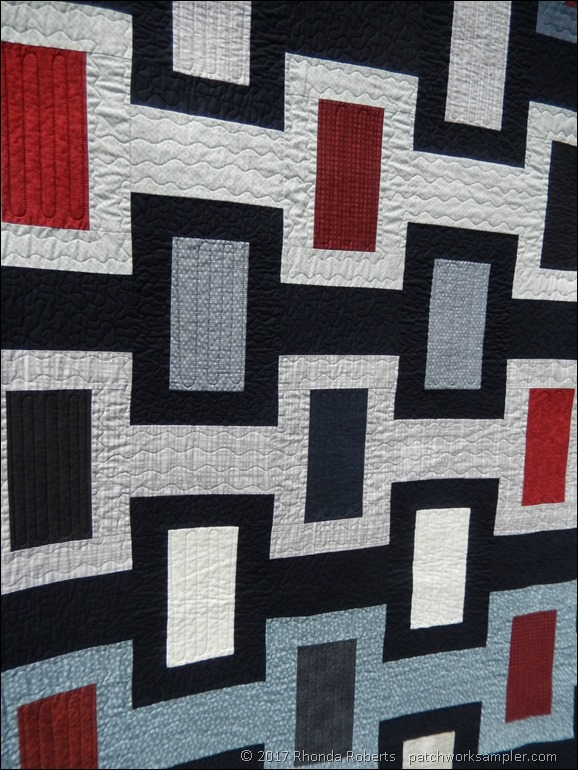 masculine black and red quilt quilting