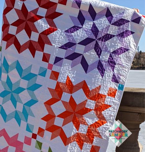 meander quilting on carpenter's star quilt